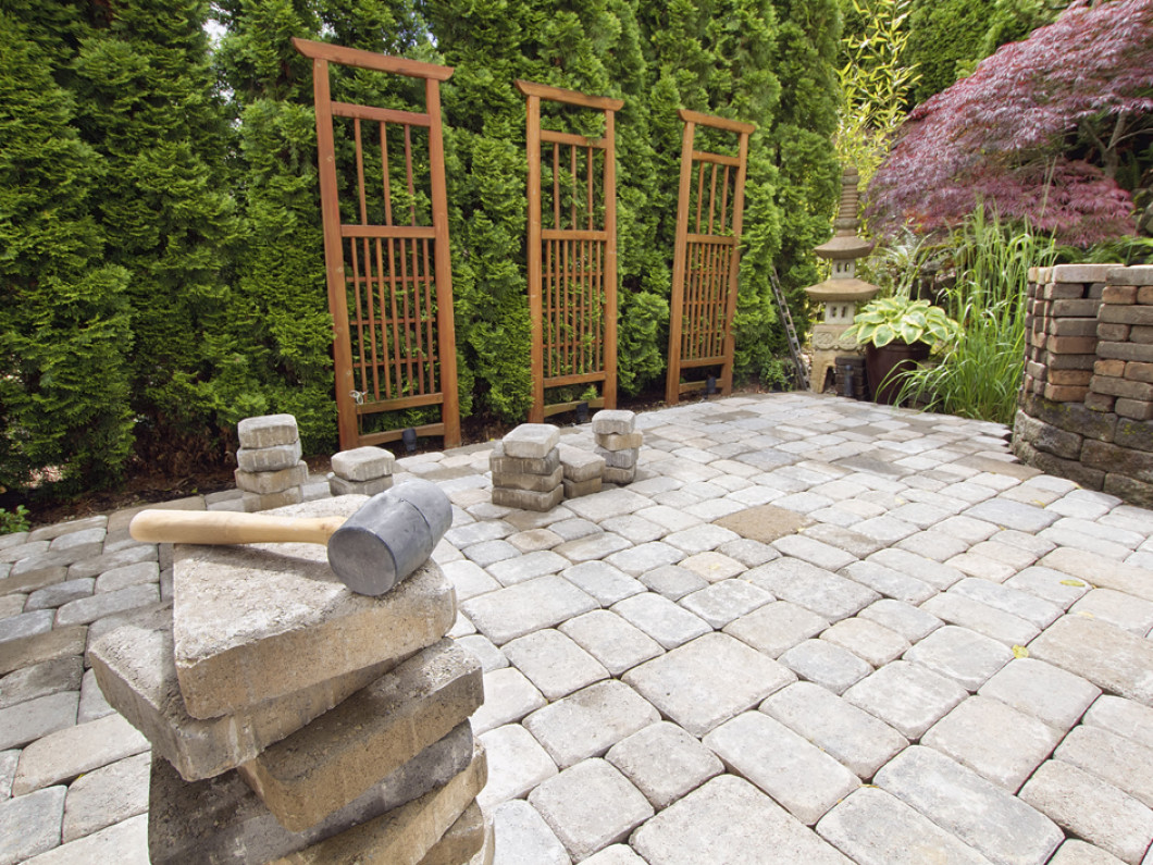 Elevate your landscape with stone patio installation